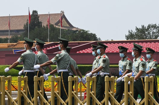 Paramilitary police officers patrol Tiananmen Square a day before an event marking the 100th anniversary of the founding of the Communist Party of China, in Beijing, June 30, 2021. Credit: AFP
