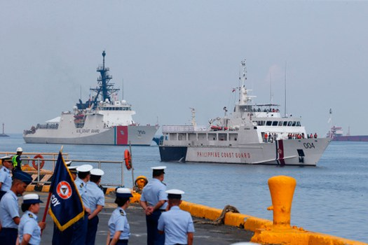 The U.S. Coast Guard cutter Bertholf (left) and the Philippine Coast Guard ship Batangas arrive in Manila following a joint exercise in the South China Sea, May 15, 2019.  Credit: AP