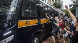 Photographers try to take photos inside a prison van transporting democracy activist Tam Tak-chi after he is denied bail and charged with sedition in Hong Kong, Sept. 8, 2020.