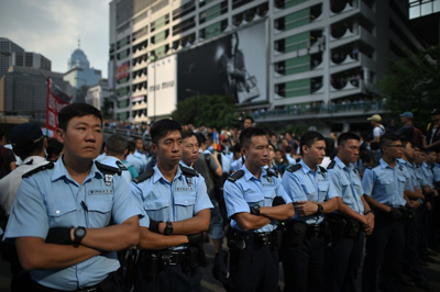 Police form a line in the Admiralty district of Hong Kong, Oct. 13, 2014. (Credit: AFP)