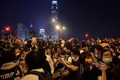 Pro-democracy demonstrators attend a protest near the Hong Kong government headquarters, Oct. 2, 2014. Credit: RFA
