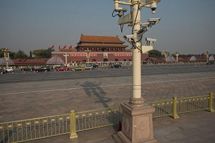 Security cameras look out over Tiananmen Square in Beijing during the unveiling ceremony of China's new Politburo Standing Committee, Nov. 15, 2012.