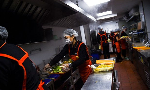 Restaurant workers in Shanghai prepare meals for app-based delivery in a file photo.