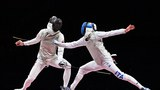 Hong Kong's Edgar Cheung (L) competes against Italy's Daniele Garozzo during the Tokyo 2020 Olympic Games, July 26, 2021.