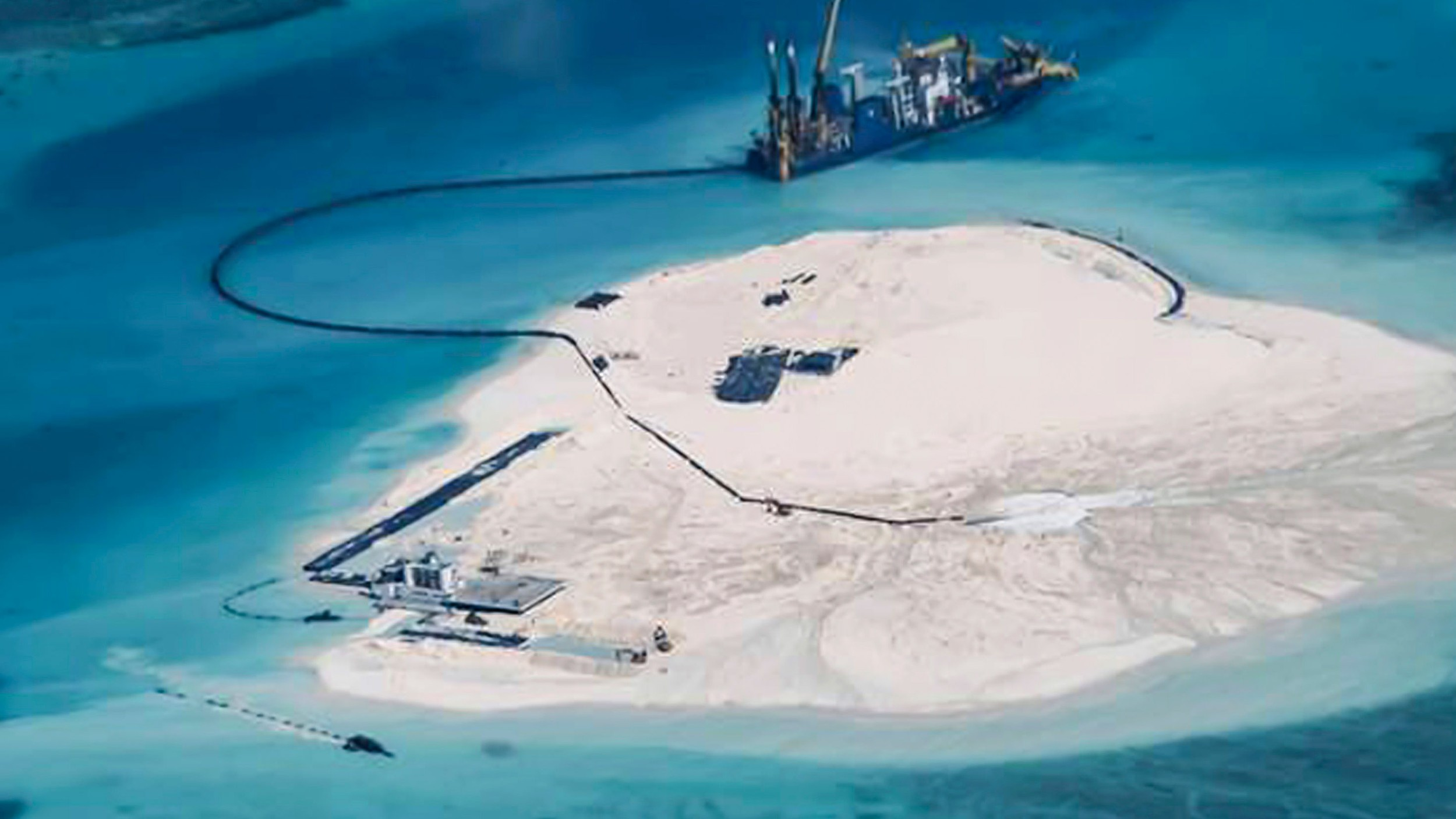 Close-up photo of Chinese dredging vessels operating around Mischief Reef in the South China Sea's disputed Spratly Islands in a U.S. Navy handout photo.