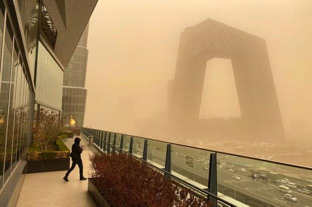 Beijing Skies Turn Orange as Northern China Hit by Sandstorms