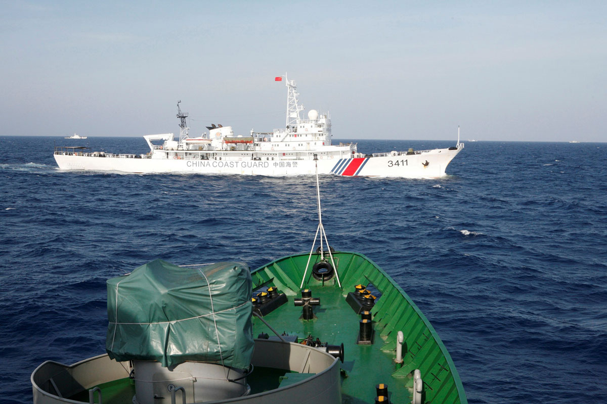 A file photo of a ship (top) of the Chinese Coast Guard is seen near a ship of the Vietnam Marine Guard in the South China Sea, about 210 kilometers (130 miles) off shore of Vietnam May 14, 2014.