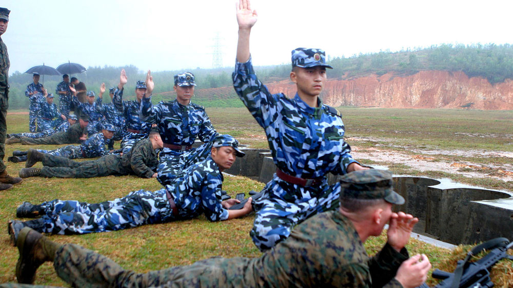 """Troops from People's Liberation Army Marine Corps at a """"Marine Day"""" get-together with visiting U.S. Marines in Zhanjiang, China on Nov. 16, 2006."""