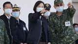 Taiwan's President Tsai Ing-wen (C) listens while inspecting military troops in Tainan, southern Taiwan, Jan. 15, 2021