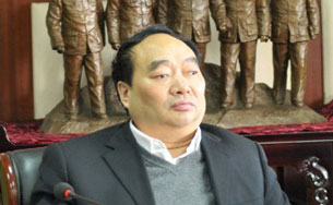 Lei Zhengfu attends a meeting in Chongqing, Nov. 16, 2012.