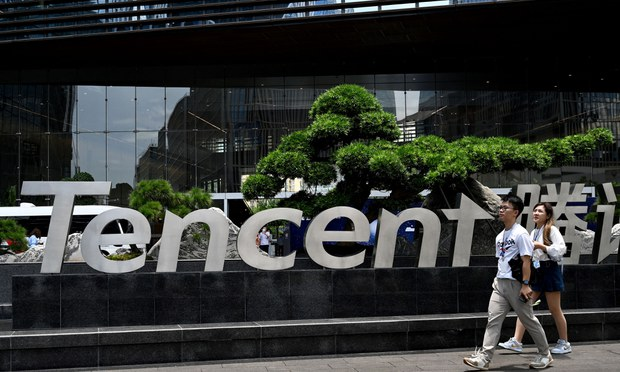 People walk past the The headquarters building of Tencent, parent company of WeChat, in the southern Chinese city of Shenzhen, May 26, 2021.