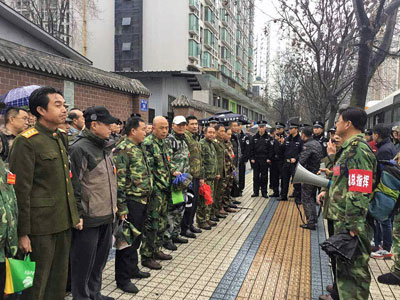 PLA veterans protest outside provincial government offices in southwestern China's Sichuan province, Feb. 22, 2017.