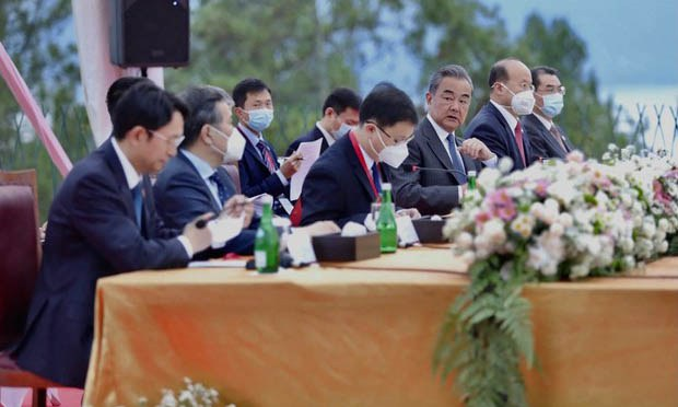 Chinese foreign minister Wang Yi (third from right) speaks with Luhut Pandjaitan, Indonesia's coordinating minister for maritime affairs and investments, during a meeting in Parapat, Indonesia, Jan. 13, 2021.