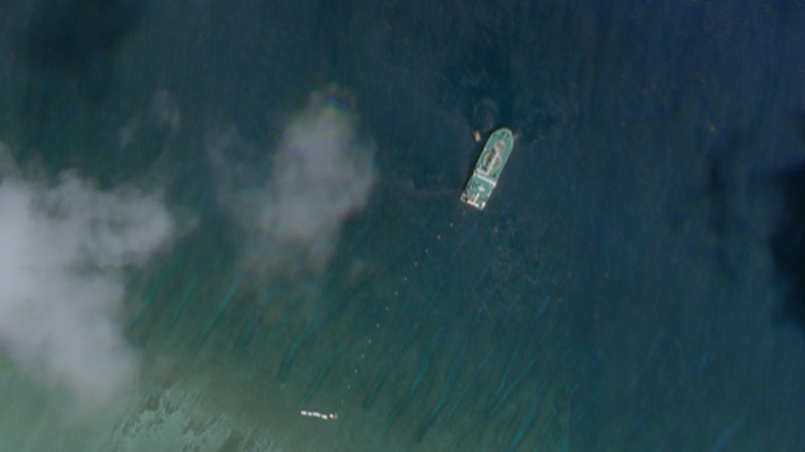 Satellite photo taken June 4 shows the Chinese cable ship Tian Yi Hai Gong just north of Tree Island, a Chinese-occupied feature in the Paracels that hosts a small military outpost and harbor.