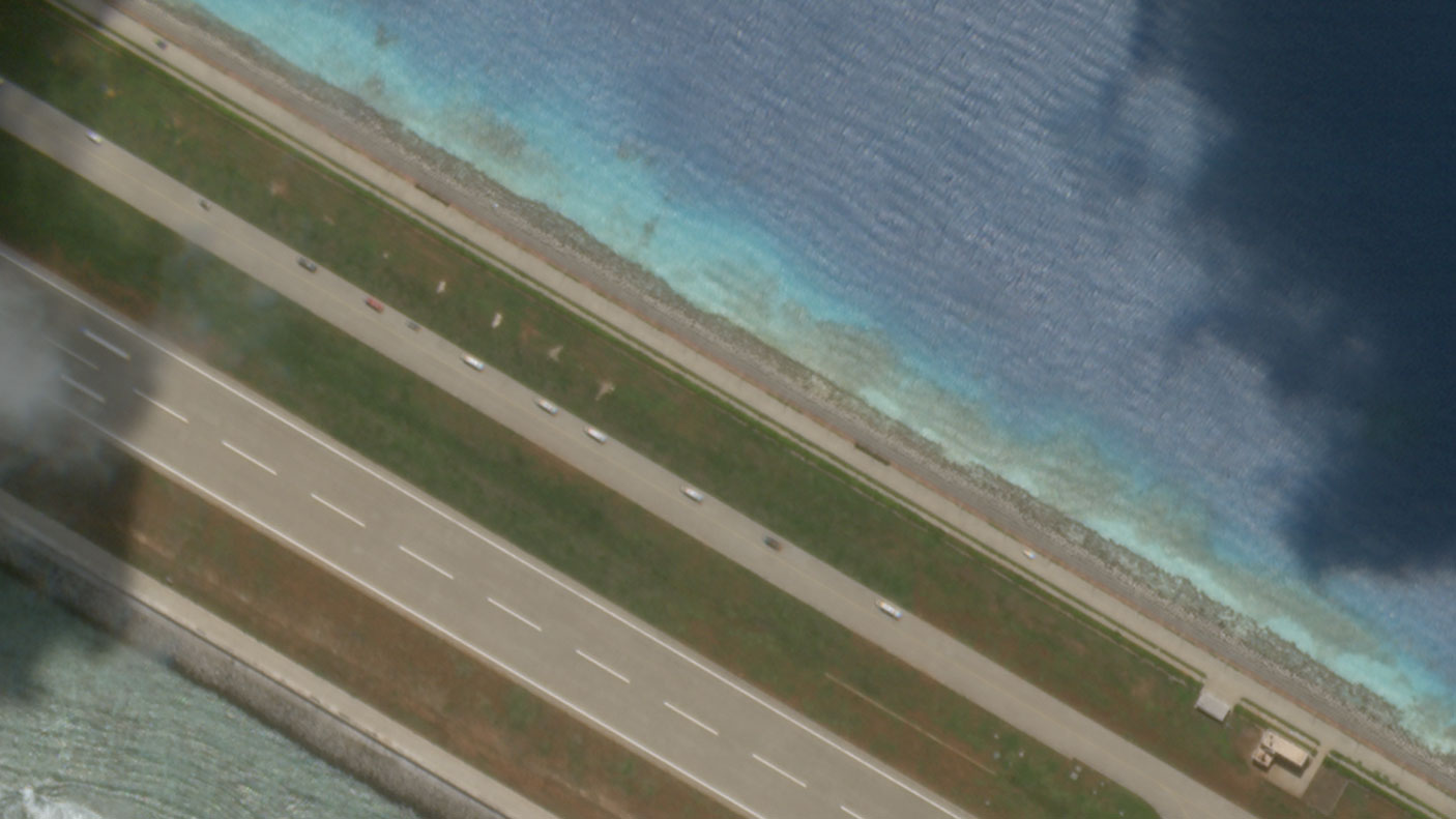 A snapshot of a few cars in the convoy at Subi Reef, next to its airstrip, on of 22 cars on the artificial island in the South China Sea, Aug 27, 2020.