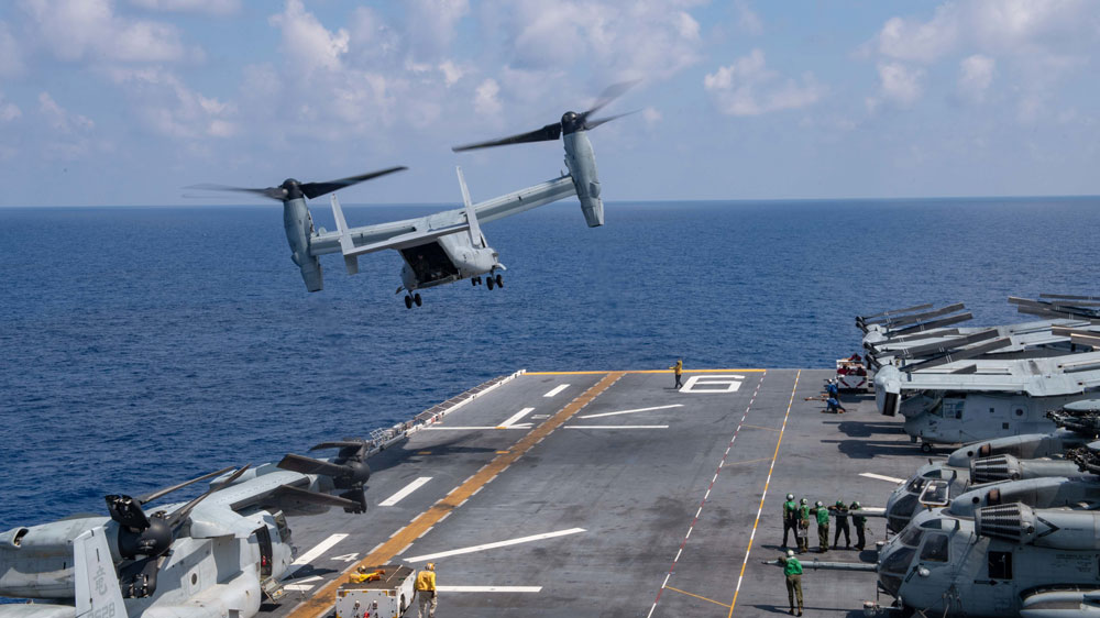 A U.S. MV-22B Osprey helicopter takes off from amphibious assault ship USS America during operations in the South China Sea, on April 19, 2020.
