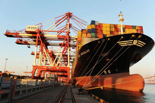 A container ship is berthed at the Port of Qingdao in Shandong province, Oct. 30, 2012.