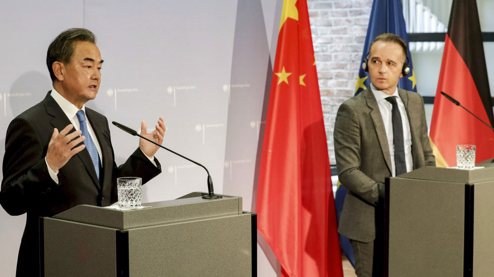 German Foreign Minister Heiko Maas (R) and China's Foreign Minister Wang Yi hold a joint press conference as part of a meeting in Berlin, Sept. 1, 2020.