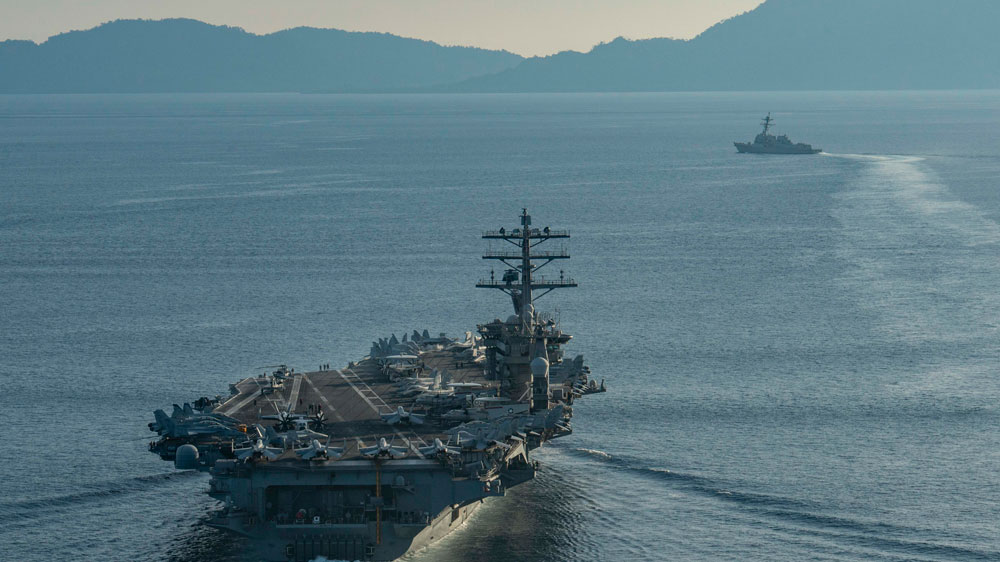 The aircraft carrier USS Nimitz and the guided-missile cruiser USS Princeton transit the Balabac Strait, which connects the South China Sea with the Sulu Sea in this July 15, 2020 photo. The Nimitz is currently on a military drill in the South China Sea.