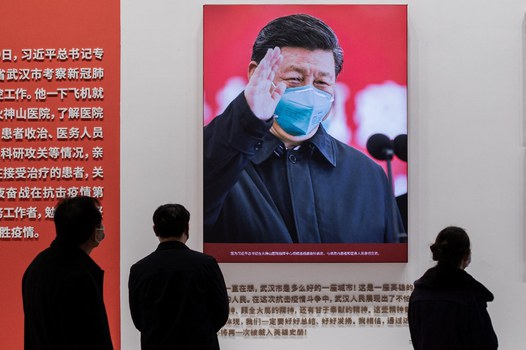 China's President Xi Jinping with a face mask shown in an exhibition about China's fight against the COVID-19 coronavirus at a convention center that was previously used as a makeshift hospital for patients in Wuhan, Jan. 15, 2021. Credit: AFP