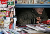 A news vendor in Beijing. Photo: AFP