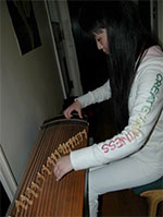 Grace Wang plays the 'Guo Zheng', a Chinese musical instrument, in her dorm room at Duke University, on April 17, 2008.