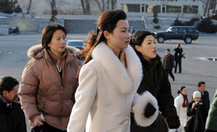 North Korean women arrive at a concert hall in Pyongyang, Feb. 26, 2008.