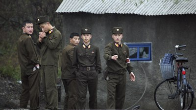 North Korean soldiers gather on the bank of the Yalu River near the North Korean town of Sinuiju, opposite the Chinese border town of Dandong in a file photo.