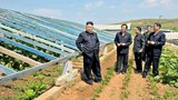 nk-kim-jong-un-farm-june-2013.jpg