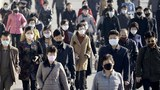 People wearing protective face masks commute amid concerns over the new coronavirus disease (COVID-19) in Pyongyang, North Korea March 30, 2020.