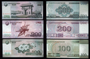 Images released by Chosun Sinbo, a pro-North Korean newspaper in Japan, show the front and back of the newly issued North Korean 500, 200, and 100 won bills, Dec. 4, 2009. Credit: Yonhap News Agency