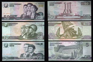Images released by Chosun Sinbo, a pro-North Korean newspaper in Japan, show the front and back of the newly issued North Korean 5, 10, and 50 won bills, Dec. 4, 2009. Credit: Yonhap News Agency