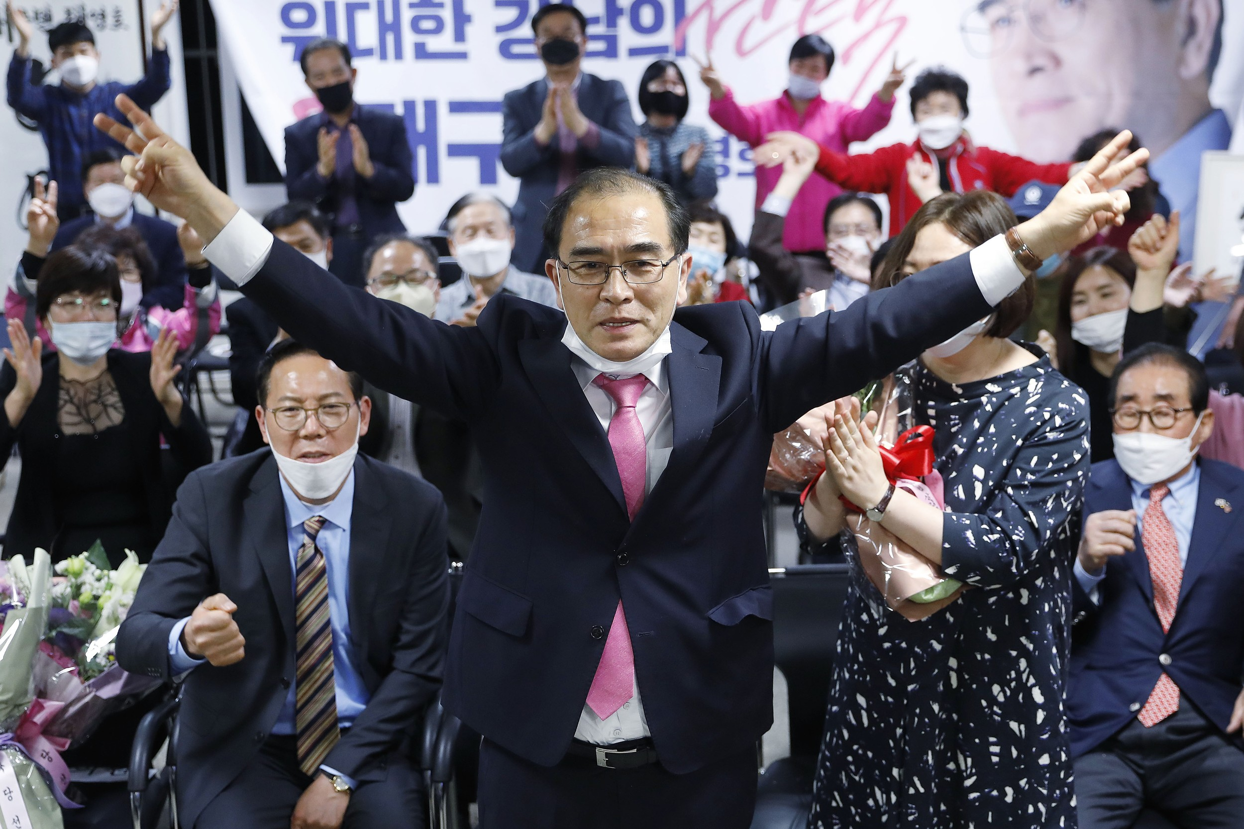 Thae Yong Ho, center, former North Korean diplomat, who defected to South Korea in 2016 and a candidate of the main opposition United Future Party, reacts after he was certain to secure victory in the parliamentary election in Seoul, South Korea, Thursday, April 16, 2020.