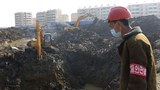 A construction site worker stands over a ground excavation project for the construction of 10,000 homes in the Songsin and Songhwa areas of Sadong District, Pyongyang, North Korea on Thursday, March 25, 2021.
