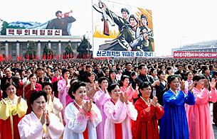 "North Koreans celebrate the ""successful launch of Kwangmyongsong-2"" on Kim Il Sung Square in Pyongyang, April 8, 2009."
