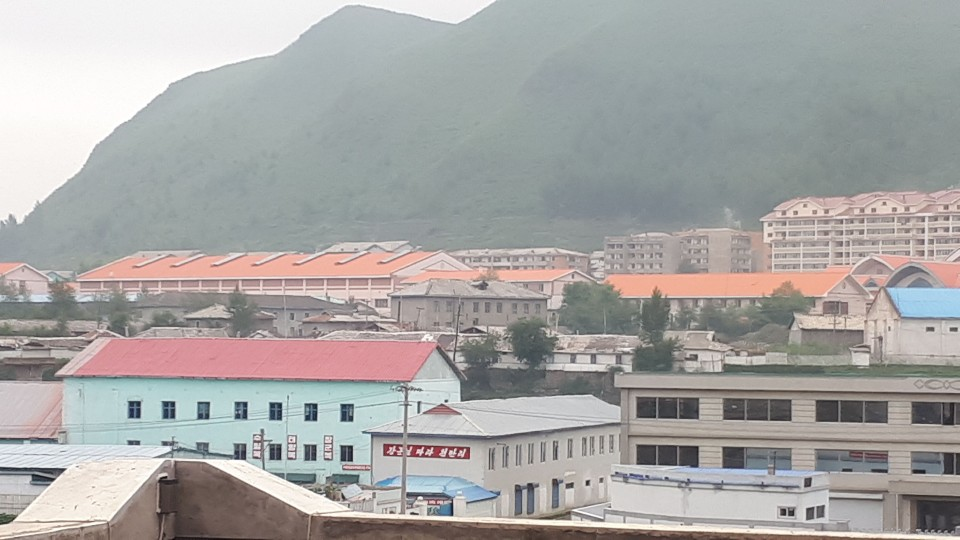 Complete view of a North Korea-China joint lumber export operation in Hyesan, North Korea, visible from across the border in China.