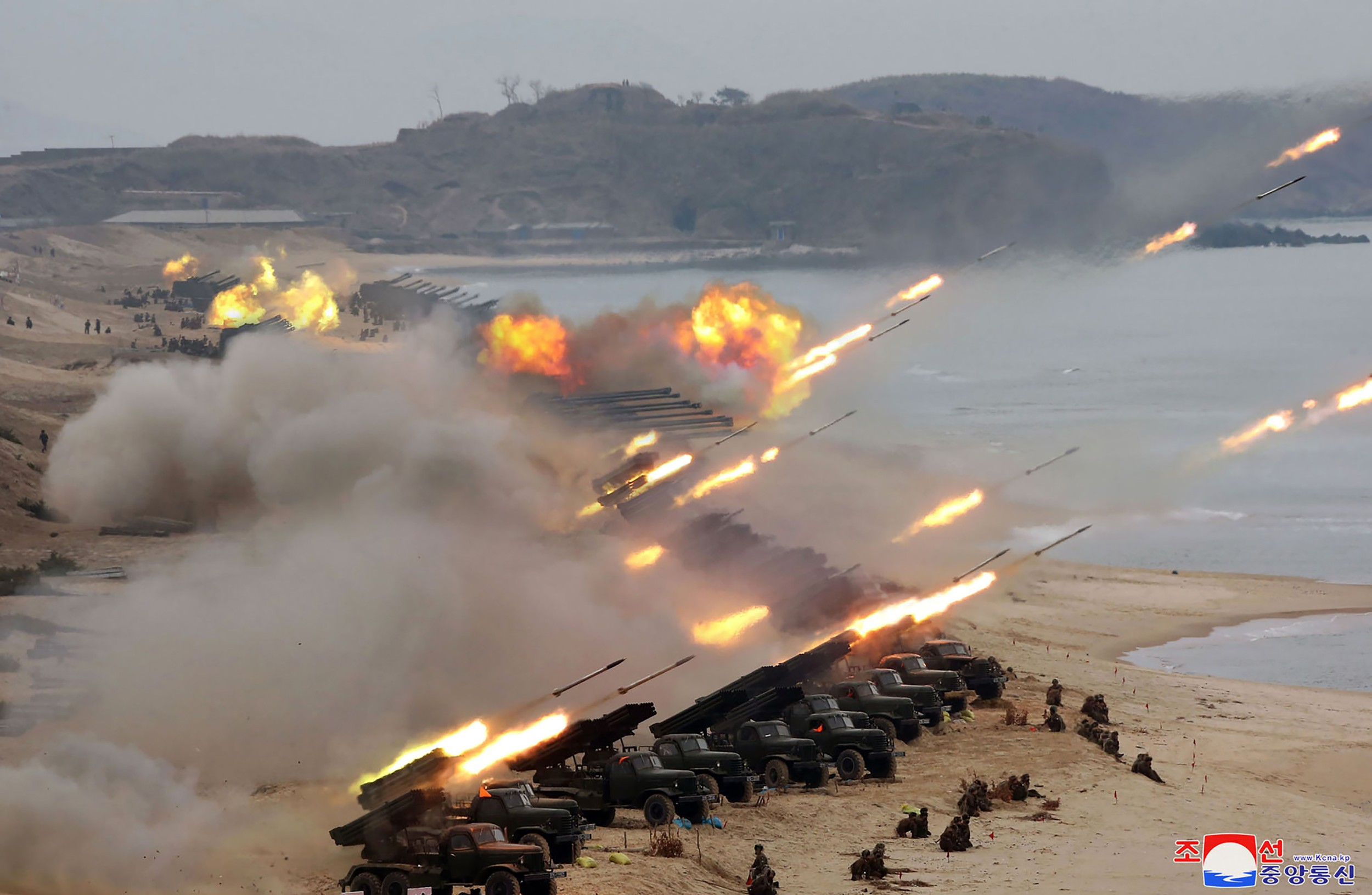 This picture taken on February 28, 2020 and released from North Korea's official Korean Central News Agency (KCNA) on February 29 shows rockets and artillery being fired during a Korean People's Army joint strike drill at an undisclosed location.