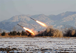 This undated picture, released by the Korean Central News Agency on Jan. 5, 2009, shows a missile firing drill from an undisclosed location in North Korea.