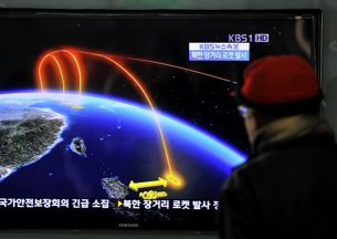 A man watches a South Korean TV broadcast on the rocket launch at a railway station in Seoul, Dec. 12, 2012. Credit: AFP.