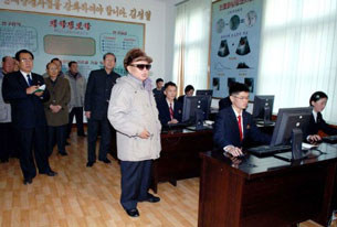 Kim Jong Il visits Pyongyang's Kim Il Sung University in an undated picture.