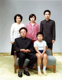 This photo taken 19 August 1981 and recently released shows North Korean leader Kim Jong-Il (sitting-L) sitting with his son, Jong-Nam (sitting-R), Kim's sister-in-law Sung Hye-Rang (L-top), Sung's daughter Lee Nam-Ok (C-top) and son Lee Il-Nam (R-top). Photo: AFP