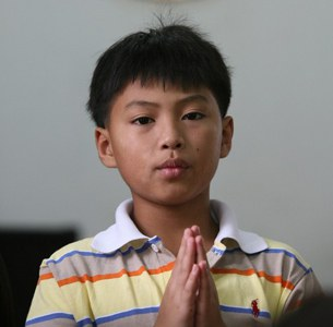 laos-boy-prays-vientiane-church-file-photo-305.jpg