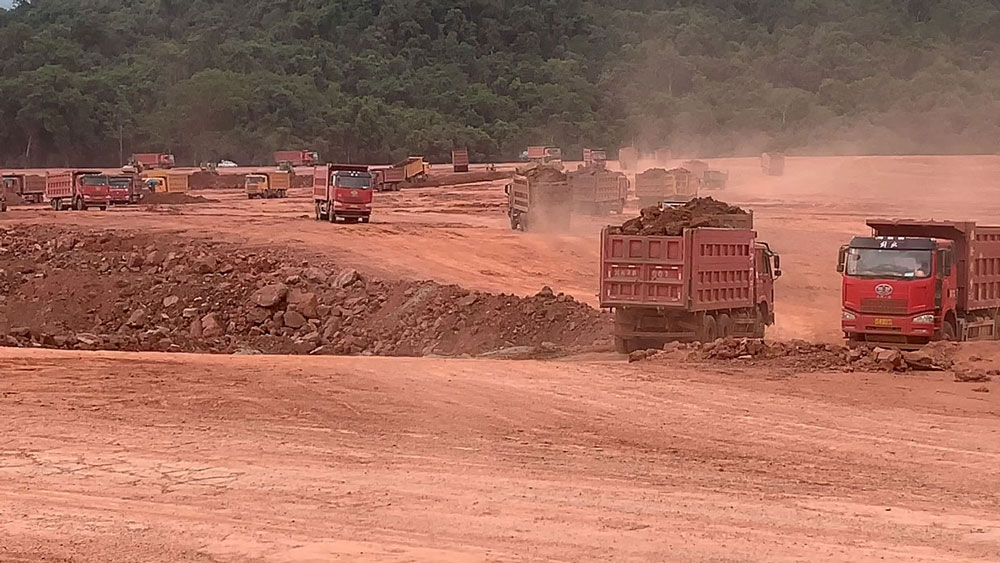 Trucks move earth at the Boten Special Economic Zone, located near Laos' main international border checkpoint with China at Mohan, Yunnan province, June 2019.