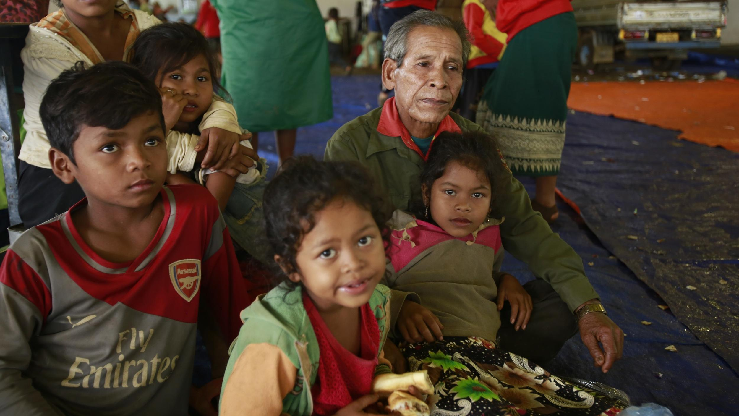 Villager Phon Vuongchonpu and his grandchildren take refuge at a shelter in Paksong town, Champasak province, Laos on Wednesday, July 25, 2018.
