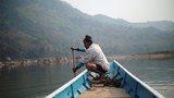 A local villager drive a boat where the future site of the Luang Prabang dam will be on the Mekong River, outskirt of Luang Prabang province, Laos, February 5, 2020.