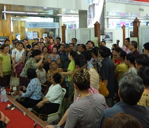 Shop owners gather for a protest at the Talat Sao mall in Vientiane, Sept. 21, 2012.