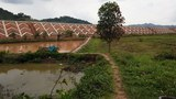 The Lao-China high-speed railway line is shown running through farmland in Oudomxay province in Laos in a file photo.