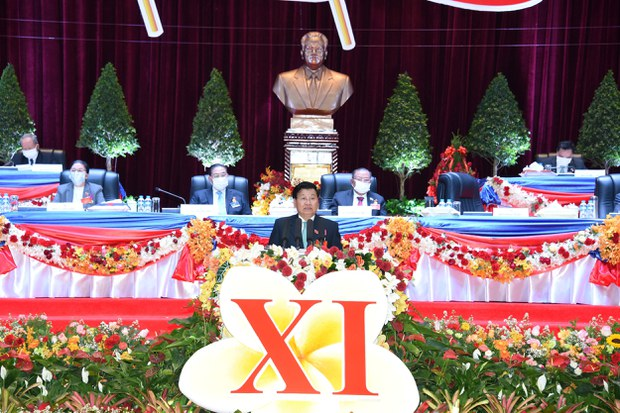 Laos' Prime Minister Thongloun Sisoulith (C) who was named as new secretary general of Laos Communist Party speaks at the closing ceremony of the 11th national congress of the communist party of Laos in Vientiane, Laos January 15, 2021.