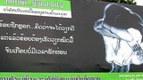 A sign in Laos warning young women and girls to 'Think carefully' and not fall victim to human trafficking is shown in a 2020 photo.