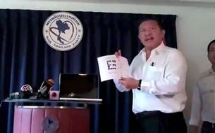 In a screen grab from a YouTube video, Chuvit Kamolvisit discloses the discovery of the Lao girls, July 29, 2012.